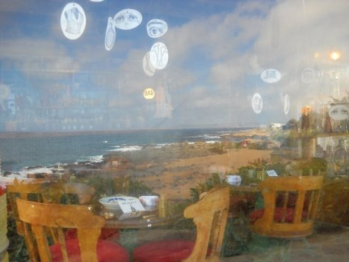 Looking into Neruda's funky eclectic bar, reflecting outwards toward the incredible blue beach of Isla Negra. Photo taken in 2010.